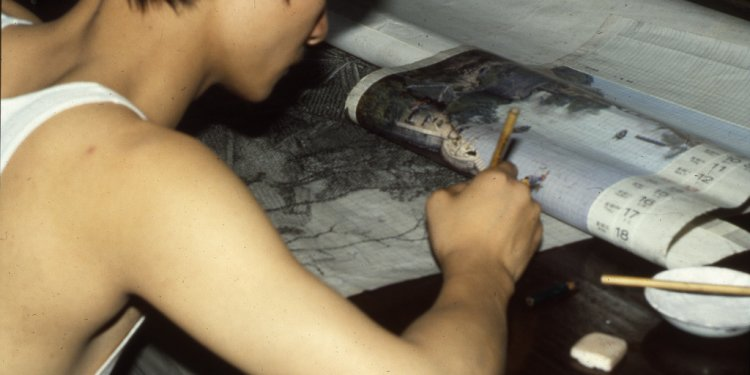 Worker translating image onto drafting paper, silk jacquard factory near Hangzchou