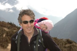 Layered synthetic fabrics keep me and my baby girl warm in the Himalayas. Photo © Liesl Clark