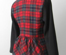 Red plaid jacket with black sleeves